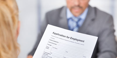Woman viewing application for employment