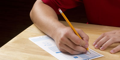 Student completing a scantron test